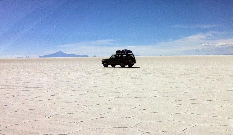 4x4 driving along the salt flats of Uyuni Bolivia
