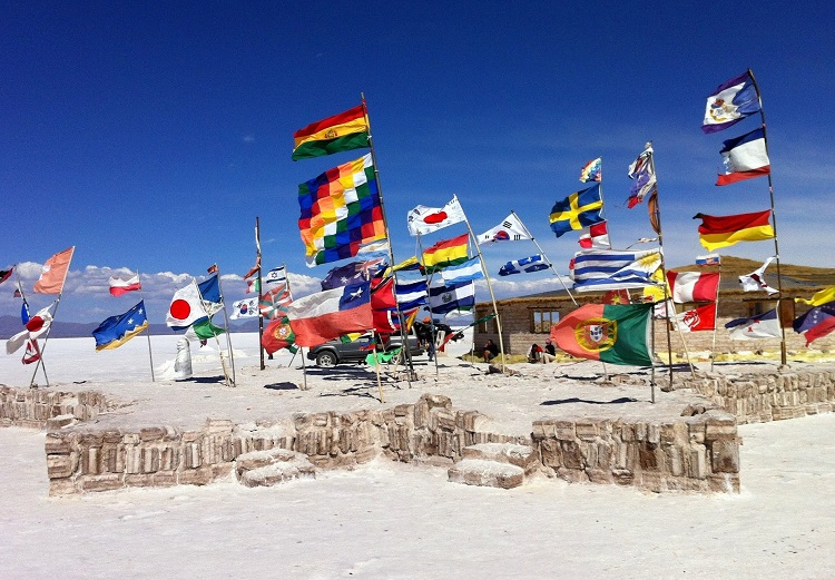 Flags left by travellers passing by the Uyuni Salt Flats